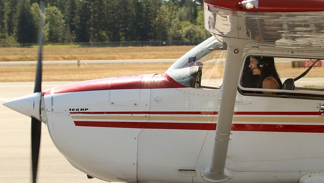 Bremerton Pilots Association scholarship recipient Maia Quigg taxis a plane to the runway while flying with instructor Don Hanson at the Bremerton National Airport on Monday.