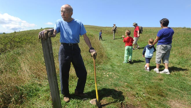 Howard McDonald, of Hendersonville, takes inventory of posts and trail markers along the Appalachian Trail at Max Patch in this 2012 photo. He has just retired from the Carolina Mountain Club's trail crew after volunteering for 22 years and donating nearly 10,000 hours of work.