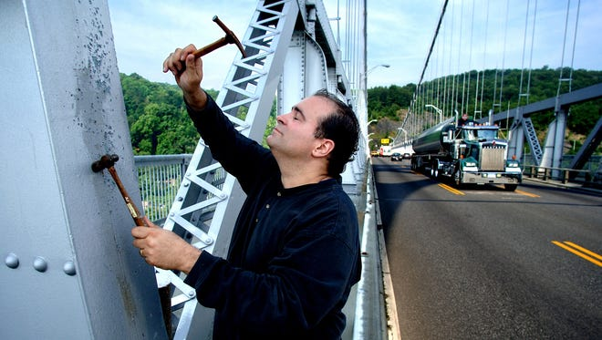 Local composer and percussionist Joseph Bertolozzi used a variety of hammers in July 2006 to play and record sounds on the steel of the Mid-Hudson Bridge in Poughkeepsie.