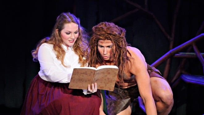 """Jane, played by Dani Saunders, tries to teach Tarzan, played by Kyle Seamans, about humans during rehearsal for the GREAT Theatre's production of """"Tarzan."""""""