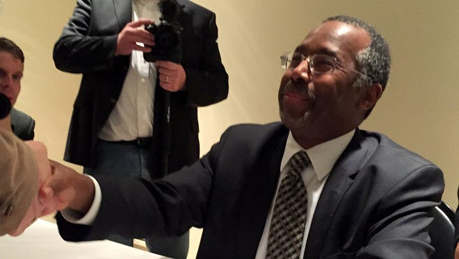 "Dr. Ben Carson signed copies of his book after his speech at The Family Leader's fundraising banquet in Des Moines on Saturday, Nov. 22, 2014. The book, which was co-written with his wife, Candy, is titled, ""One Nation: What We Can Do to Save America's Future."""