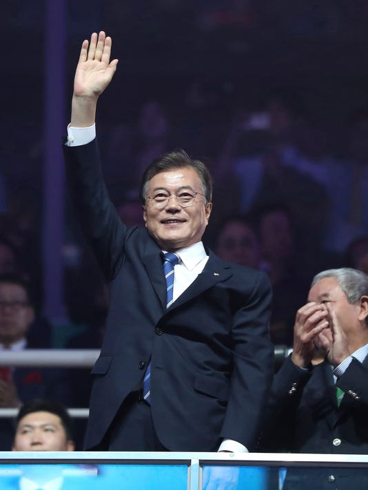 South Korean President Moon Jae-in waves during the opening ceremony of the World Taekwondo Championships in Muju, South Korea, Saturday, June 24, 2017. Moon said Saturday he hopes to see North Korean athletes at next year's Winter Olympics in South Korea to ease tensions over the North's nuclear program. (Kim Ju-hyoung/Yonhap via AP)