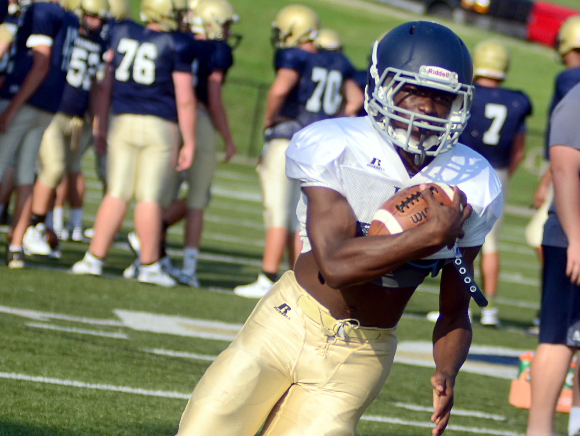 Pope John Paul II High senior tailback Jamaal Thompson cuts outside for yardage during Friday's scrimmage against Sycamore.