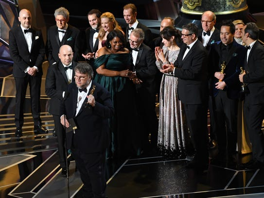 Guillermo del Toro accepts the Oscar for best picture.