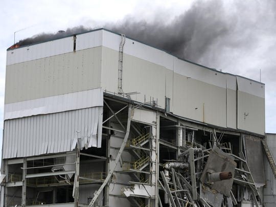Firefighters battle a blaze Thursday morning at the Fox Valley Energy Center in Neenah.