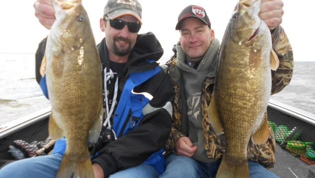 John Schlussler from St. Paul, MN and Stever Leach from Maplewood, MN joined Jeff Evans for some smallmouth bass fishing in September 2014.