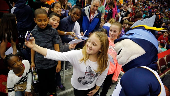 Lexie Montan, a 10-year-old fifth-grade student at Greenwood takes a selfie with Iowa Energy mascot Surge during Tuesday's game at Wells Fargo Arena. The Sioux Falls Skyforce beat Iowa 112-109 on a last-second shot.