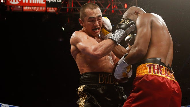 Beibut Shumenov returns against B.J. Flores on July 25. (Geoff Burke-USA TODAY Sports)