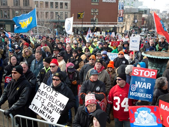 Protesters meet Tuesday at the State Capitol in Madison to rally against a right-to-work bill that was brought up in an extraordinary session.