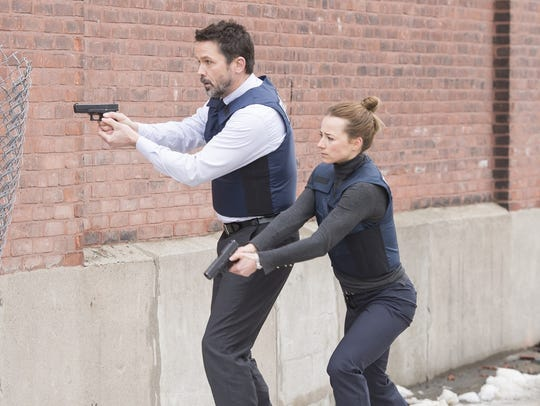 Billy Campbell as John Cardinal and Karine Vanasse