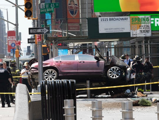 A car rests on a security barrier in New York's Times