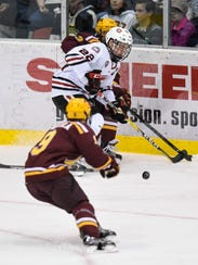St. Cloud State's Jimmy Schuldt advances with the puck