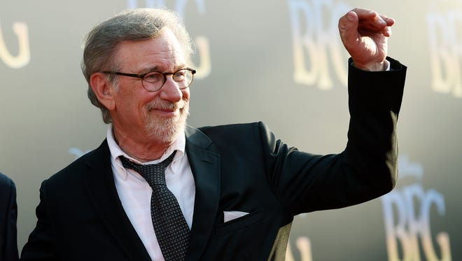 """Steven Spielberg, director/co-producer of """"The BFG,"""" waves to photographers at the premiere of the film at the El Capitan Theatre earlier this month."""
