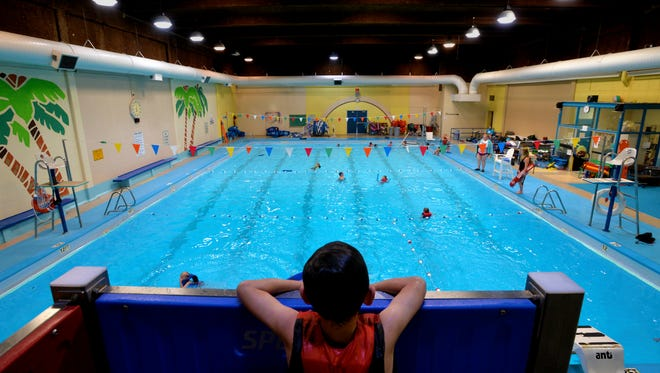 Kids swim at the Natatorium, which closed in late 2018. The city plans to apply for funds through a Department of Defense program that would also allow it to partner with Malmstrom Air Force base to share the cost of construction of a new indoor poor and recreation center.