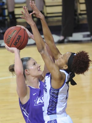 ACU's Sierra Allen shoots over a Central Arkansas defender. The Sugar Bears beat ACU 73-61 in the Southland Conference game Saturday, Feb. 24, 2018 at Moody Coliseum.