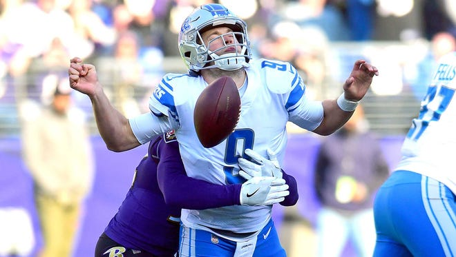 Detroit Lions quarterback Matthew Stafford fumbles the ball while being sacked by Baltimore Ravens safety Eric Weddle in the second quarter at M&T Bank Stadium.