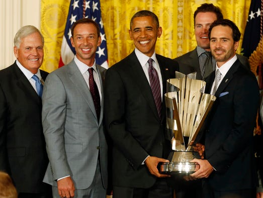 Six-time NASCAR Sprint Cup champion Jimmie Johnson, right, team owner Rick Hendrick, left, crew chief Chad Knaus, second from left, and the No. 48 Hendrick Motorsports team were honored by President Barack Obama at the White House  on June 25 for winning the 2013 championship.