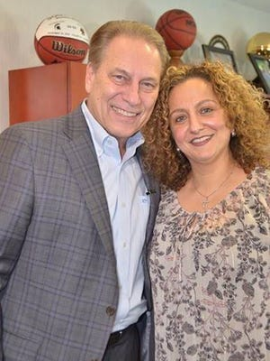 Michigan Excellence in Education winner Nancy Kattoula with Michigan State basketball coach Tom Izzo.