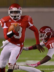 Lee's Shaquille Johnson (13) runs with the ball early in their game with Prattville at Cramton Bowl on Friday, Oct. 24, 2014.