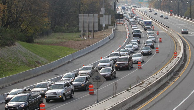 Traffic backs up on I-95 near Wilmington in early 2015, as a result of road construction. DelDOT is considering a plan to pay for projects through a user fee rather than with fuel taxes.