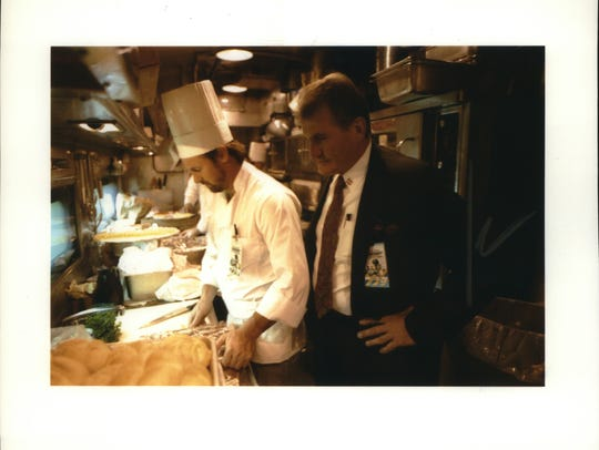 Hans Weissberger checks the progress of his chefs while