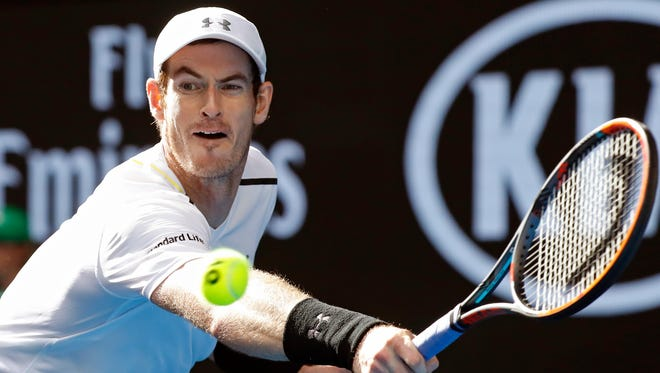 Britain's Andy Murray makes a backhand return to United States' Sam Querrey during their third round match at the Australian Open tennis championships in Melbourne, Australia, Friday, Jan. 20, 2017.