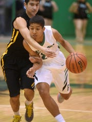 Farmington's Tyren King drives to the basket during a game against St. Pius X on Jan. 16 at Scorpion Gym.