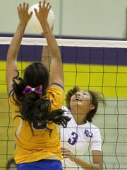 Kirtland Central's Gabrianna White-David, right, records a kill against Bloomfield on Thursday at Kirtland Central.