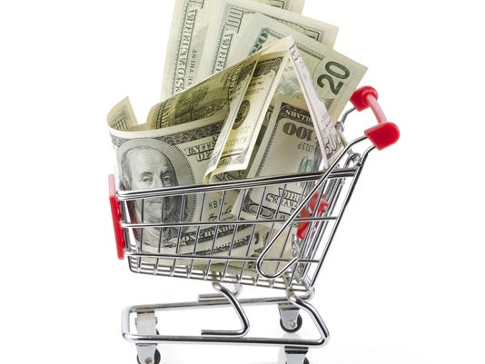 Money in shopping cart.