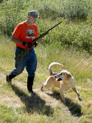 Larry Housman, from Baltimore, and his dog, Hank, prepare