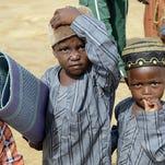 Muslim boys in Nigeria's central city of Jos July 17, 2015.
