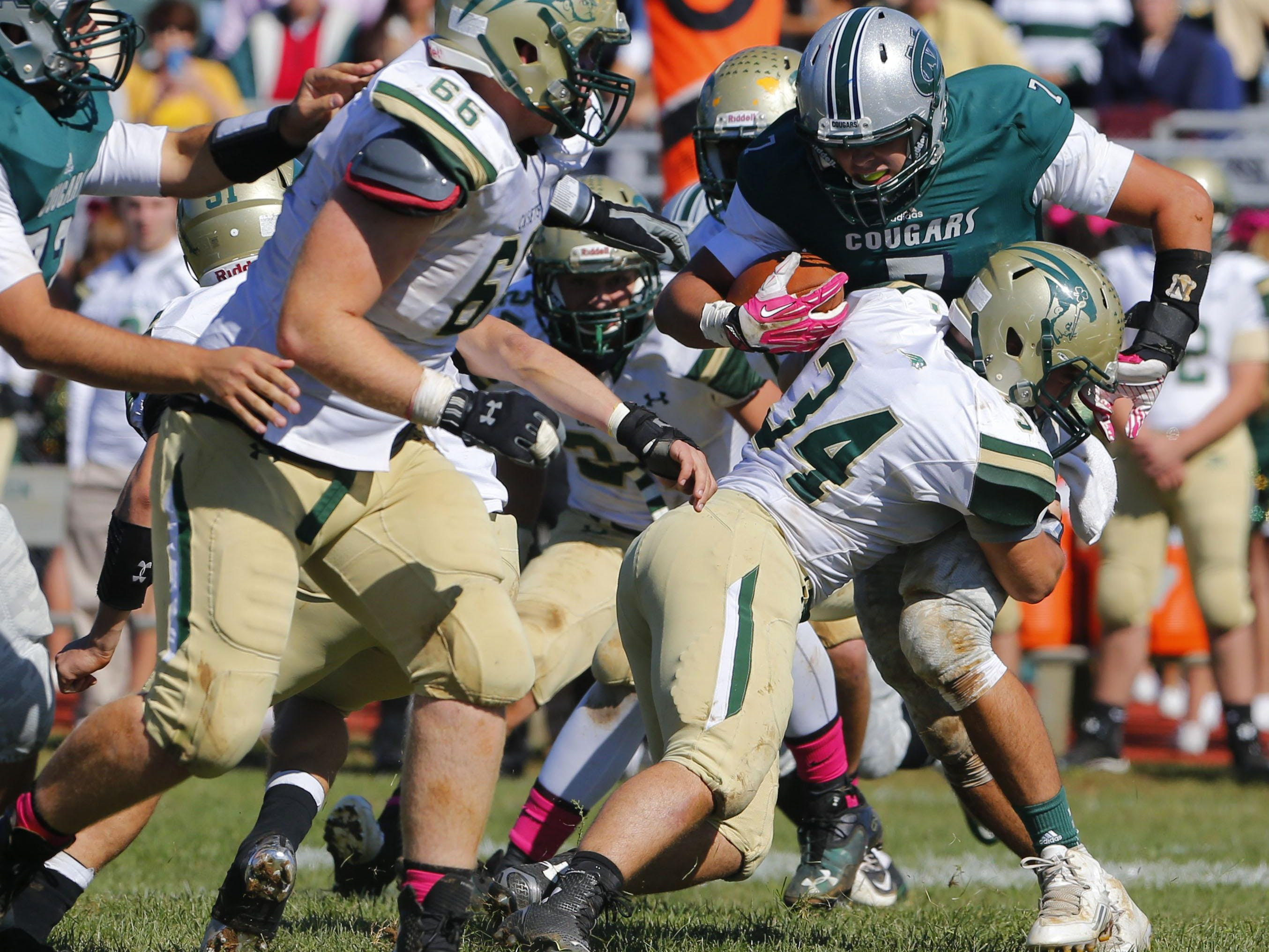 Max Mullaney (7) of Colts Neck is Stopped by Joey Hagan (34) of Red Bank catholic during game at Colts Neck High School, Colts Neck,NJ. Saturday, October 10, 2015.