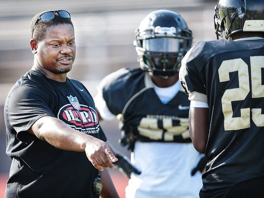 Whitehaven Coach Rodney Saulsberry work with the team