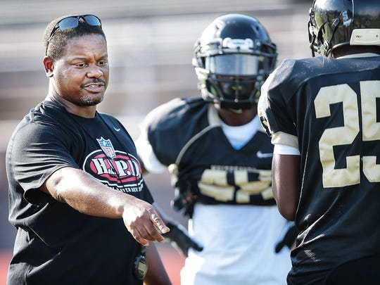 Whitehaven Coach Rodney Saulsberry work with the team at practice Wednesday evening. The Tigers lost 35 seniors from last year's championship team but are still ranked No.1 in the preseason Dandy Dozen this year.