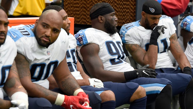 The Titans defense sits dejectedly on the bench during the loss to the Texans on Sunday, Oct. 1, 2017, at NRG Stadium.