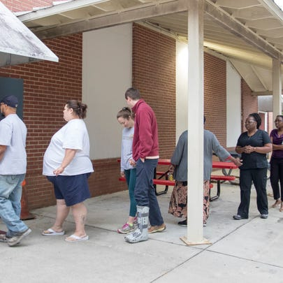 Voters make their way into the polling location at