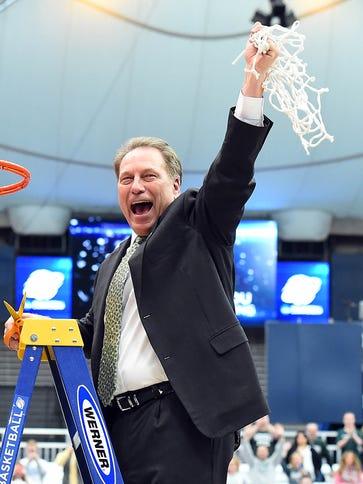 Michigan State Spartans head coach Tom Izzo cuts down