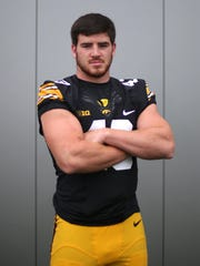 Iowa sophomore outside linebacker Josey Jewell poses for a photo during the University of Iowa football team's media day on Saturday, Aug. 8, 2015, in Iowa City, Iowa.