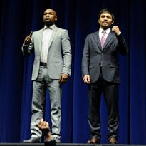 Mar 11, 2015; Los Angeles, CA, USA; Floyd Mayweather and Manny Pacquiao pose for photographers during a press conference to announce his fight with Manny Pacquiao on May 2, 2015 at the Nokia Theater in Los Angeles. Mandatory Credit: Robert Hanashiro-USA TODAY Sports