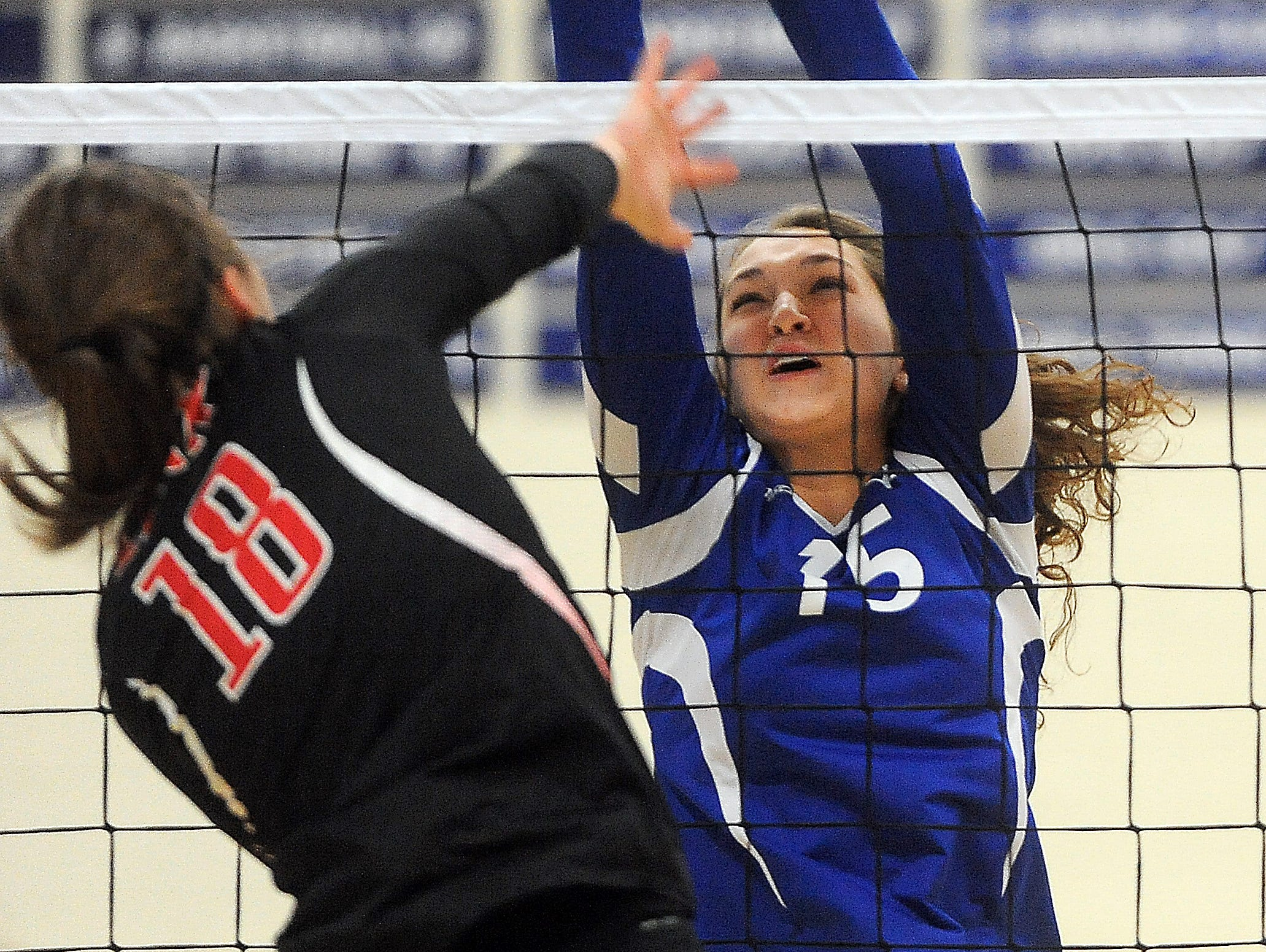 O'Gorman's Katie Messler blocks a spike from Brandon Valley's Elsie Zajicek during their game at O'Gorman High School.