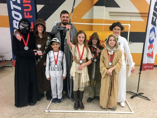 Team Defenders stand for a photo at the second annual Alamogordo FIRST LEGO League qualifier and FIRST LEGO League Jr. Expo Saturday, Jan. 13.