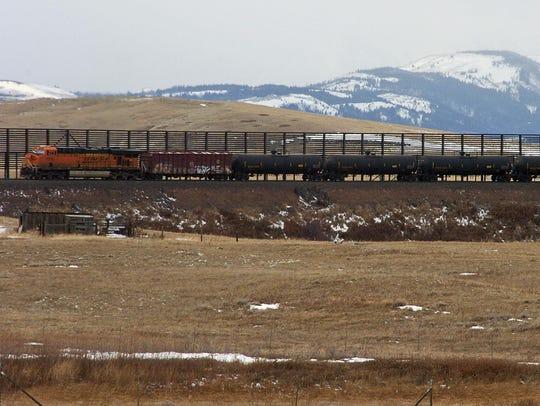 A train hauls oil into Glacier National Park near the