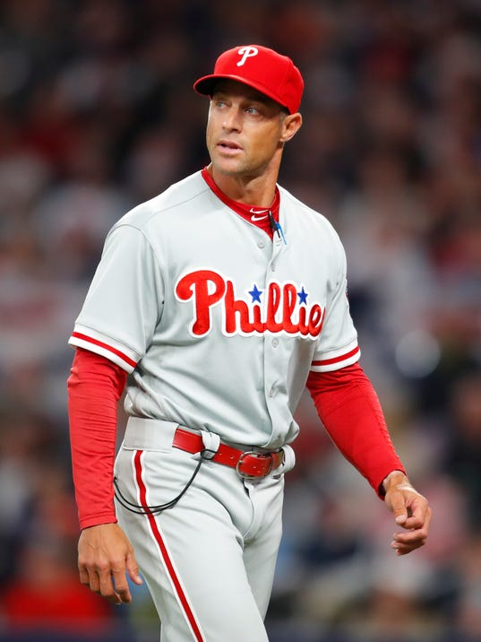 Philadelphia Phillies manager Gabe Kapler walks back to the dugout after a pitching change in the third inning of a baseball game against the Atlanta Braves, Saturday, March 31, 2018, in Atlanta. (AP Photo/Todd Kirkland)