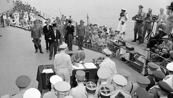 This is the scene aboard the battleship Missouri as the Japanese surrender. Documents were signed in Tokyo Bay, Sept. 2, 1945.