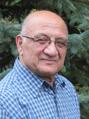 Artist and teacher Ehsan Kousari