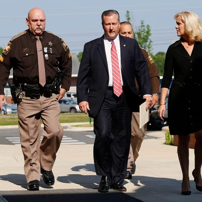 Mike Hubbard and wife Susan Hubbard walk to the Lee
