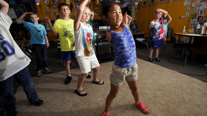 Zoe Bosanic, 7, leads a dance break in teacher Sarah Hingst's class at Schavey Rd. Elementary in DeWitt. Zoe takes dance classes outside school to go along with the many sports she plays.