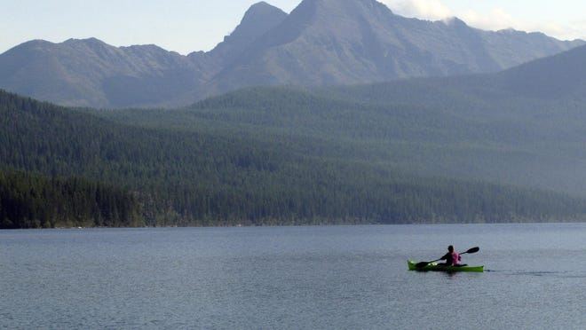 Ingrid Forsmark kayaks on Kintla Lake in Glacier National Park, Mont.