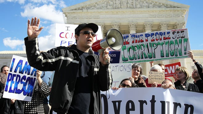 Eric Byler, Co-founder and President of the Coffee Party, speaks during a protest in front of the U.S. Supreme Court February 23, 2012 in Washington, DC. Activist groups Free Speech For People, the Coffee Party and Common Cause co-hosted the rally to urge the Supreme Court to overturn Citizens United v. Federal Election Commission, the decision that prohibits the government from putting limits on political spending by corporations and unions.
