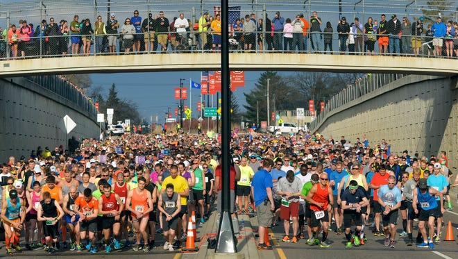 More than 1,400 participants leave the line Saturday, April 16, for the start of the Earth Day Half Marathon in St. Cloud. The event started and ended on the campus of St. Cloud State University.